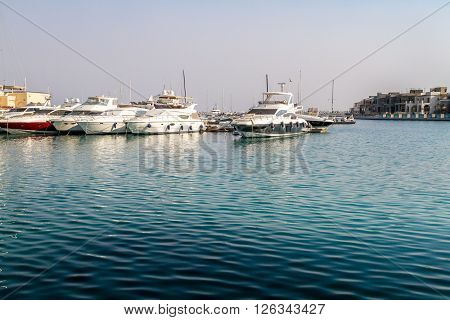 LIMASSOL, CYPRUS - SEPTEMBER 7: White yachts moored in Limassol marina, Cyprus on September 7, 2015