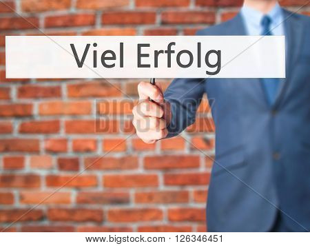 Viel Erfolg  (much Success In German) - Businessman Hand Holding Sign