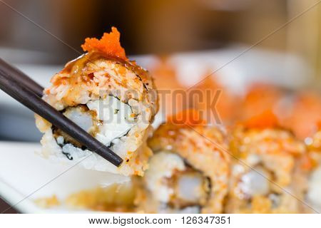 Sushi roll with salmon and shrimp tempura in restaurant