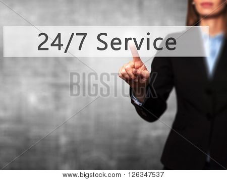 24/7 Service - Businesswoman Hand Pressing Button On Touch Screen Interface.
