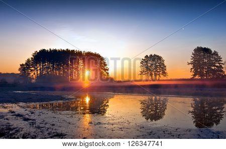 Sunrise over the lake spring landscape, foggy