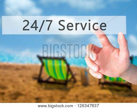 24/7 Service - Hand Pressing A Button On Blurred Background Concept On Visual Screen.