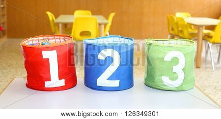 Three Containers For Toys With Numbers One Two Three In A Class Of Kindergarten