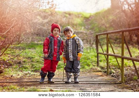 Two Cute Children, Boy Brothers, Playing Together In The Park, Rural Village Environment, Springtime
