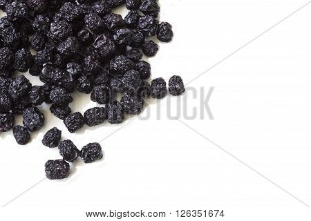 Dried chokeberry (aronia berry) on a white background