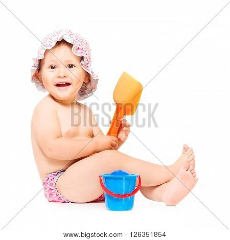 Little baby girl siting in swimming pants and sunhat, isolated over white