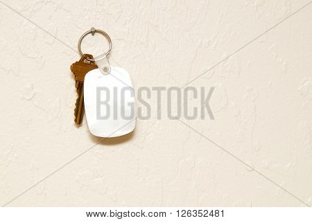 Keyring With Key And Fob On Wall