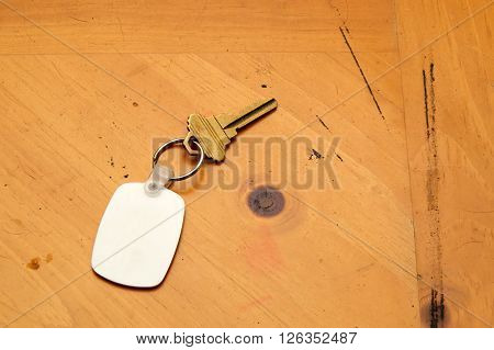 Keyring With Key And Fob On Wood Table