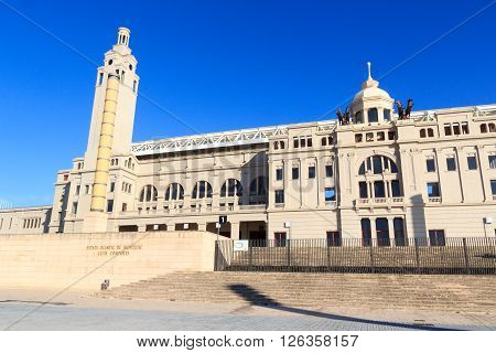 Barcelona, Spain - November 12, 2015: Barcelona Olympic Stadium (Estadi Olimpic Lluis Companys) facade. The stadium built in 1927 was renovated in 1989 to be the main stadium for the 1992 Summer Olympics.