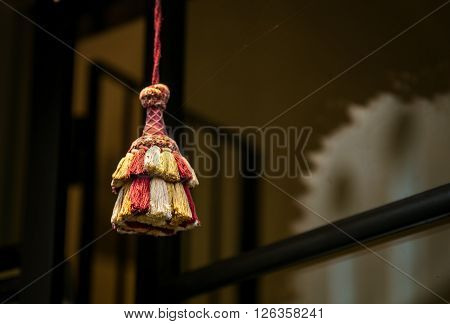 Colorful cloth tassel on the end of a string