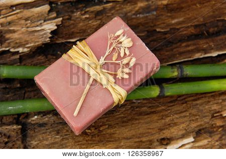 Soap closeup.with bamboo grove on old wood