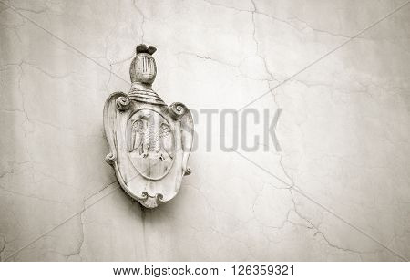 Religious symbol on a church wall in Florence
