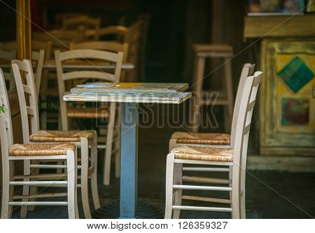 Wooden chairs and table of a cafe