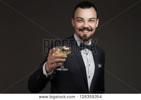 Fashionable young man with a glass of champagne