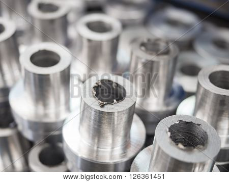 turning steel part by manual lathe machine