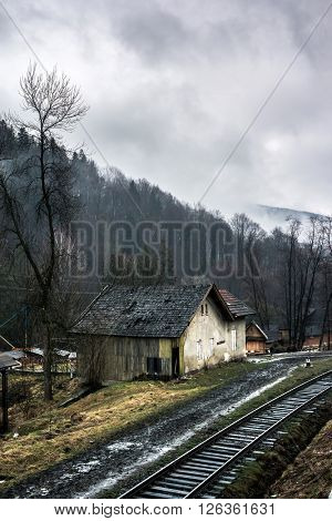 beautiful landscape with old house by railroad