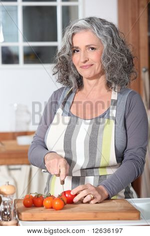Portrait of a senior woman cooking