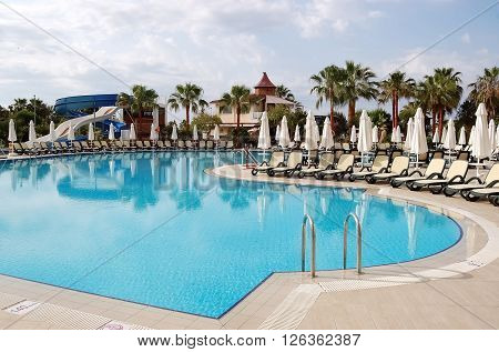 Side, ANTALYA, TURKEY - JUNE 03, 2015: View of the pool and palms from the hotel Bella Resort, Turkey.