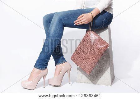 Closeup of a fashionable woman oversized envelop bag