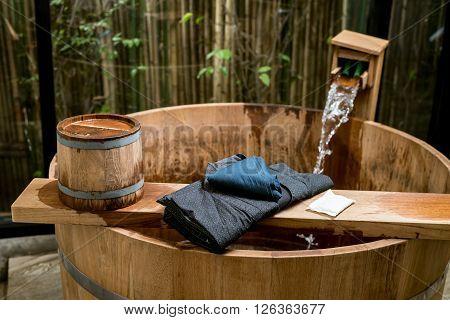 Onsen series : Blue yukata on wooden bathtub