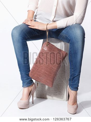 Close-up of a trendy oversized leather envelop bag