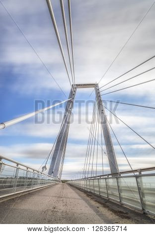 Cable Bridge in Umea Sweden with a partly cloudy sky
