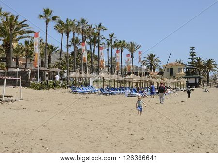 MARBELLA, SPAIN - APRIL 9, 2016: Some people at the beach in a day in spring in Marbella Spain.