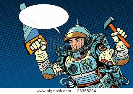 Astronaut with tools for repair hammer and saw pop art retro style