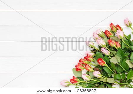 Bouquet Of Small Roses On White Wooden Background. Top View, Copy Space