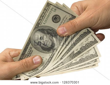 One hand gives money in other hand over white background