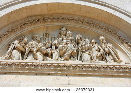 Basilica of St. Peter - Pecs Hungary scene on facade.