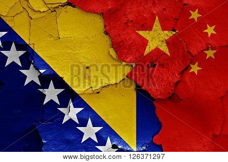 flags of Bosnia and Herzegovina and China painted on cracked wall