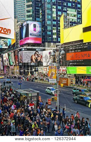 NEW YORK USA - APRIL 26 2015: Crowded 7th Avenue and West 44th Street in Midtown Manhattan New York USA. It is called Times Square. Tourists around