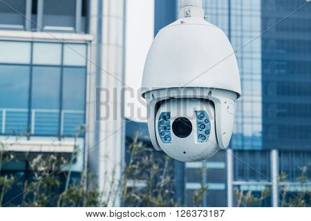 close-up view of security camera,in front of office building.