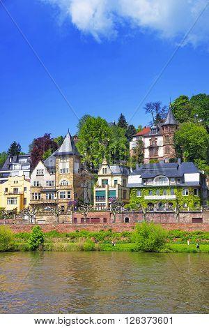 View of Quay of Neckar river in Heidelberg in Germany. Heidelberg is a city in Baden-Wurttemberg in Germany.