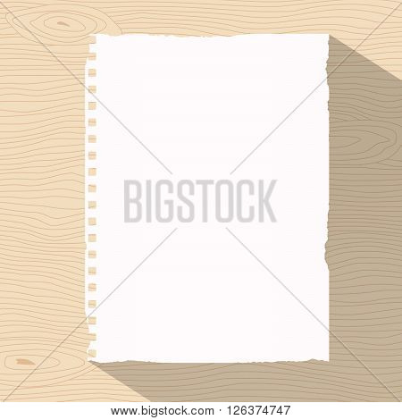 Piece of ripped white notebook paper is sticked on light brown wooden wall or desk.