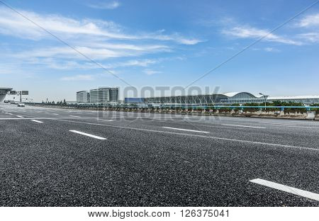 road near by the airport under the blue sky