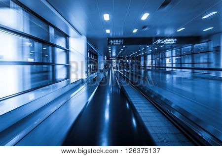 moving walkways at pudong international airport,motion blurred.