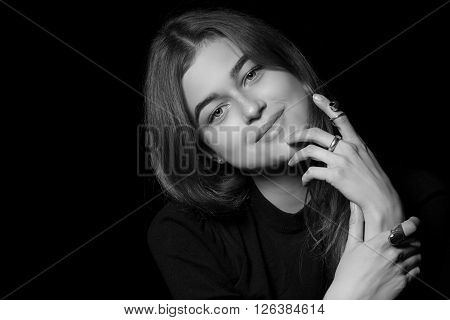 Portrait of a girl with diamonds on black background