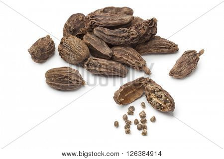Black cardamom fruit and seeds  on white background