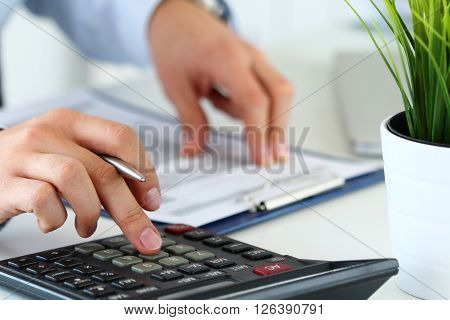 Close Up View Of Bookkeeper Hands Calculating Balance