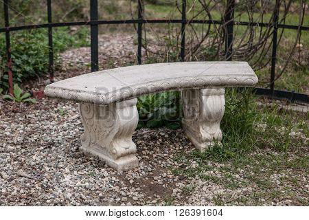 Elegant stone ancient bench, garden architecture, background