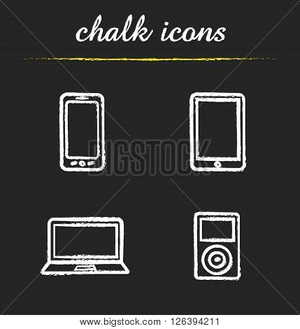 Consumer electronics chalk icons set. Smartphone and tablet computer. Laptop and mp3 player. Multimedia electronic gadgets. White illustrations on blackboard. Vector chalkboard logo concepts