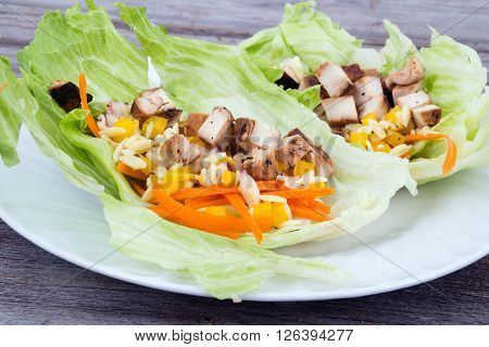 Lettuce wraps with chicken and orzo with carrots