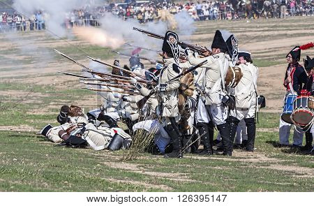 BAILEN SPAIN - october 5 2008: Taken in Bailen Jaen province during the commemoration of the anniversary of the battle of bailen of 1808 Spanish soldier firing a gun during the Representation of the Battle of Bailen BailEn JaEn province Andalusia Spain