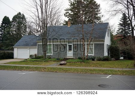 HARBOR SPRINGS, MICHIGAN / UNITED STATES - DECEMBER 23, 2015: A small gray home, labeled