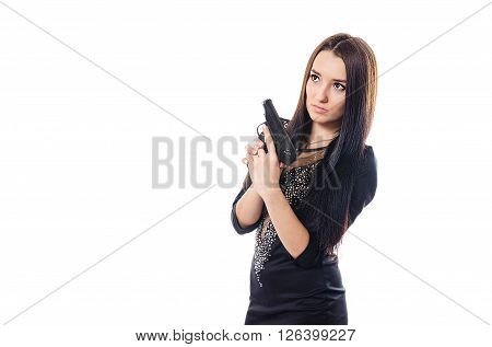 The serious young girl with the gun in a black dress