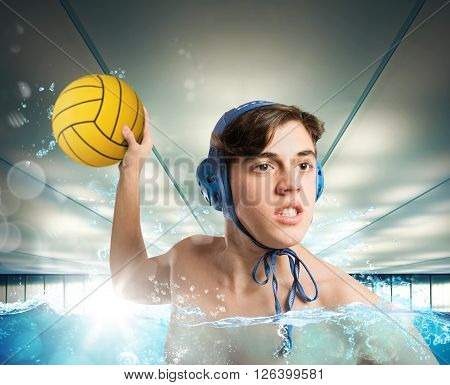 Water polo boy player pulls a ball