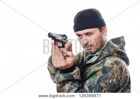 The person in a camouflage and black to a cap about the pistol