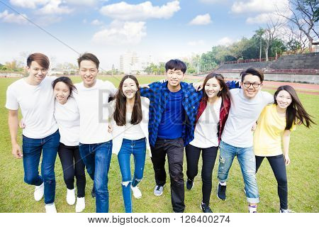 Happy young group of students walking together